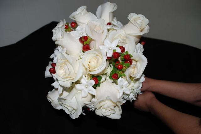 A Southern California Wedding bouquet of Stephanotis - White Roses and Red Coffee Beans
